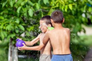 Kids playing with water balloons